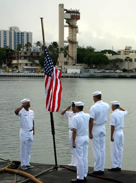 Sailors of the USS CHICAGO (SSN 721) Lower the flag to half mast on 9/11