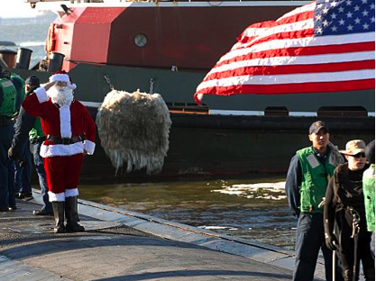 Santa salutes as USS BOISE makes it home from deployment in time for the holidays.
