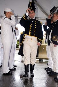 CDR Tim Cooper salutes the sideboys as he arrives to relieve as CO of USS CONSTITUTION